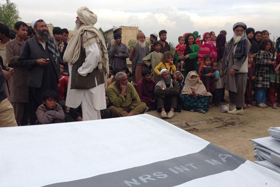 distributing tarpaulins in Afghanistan