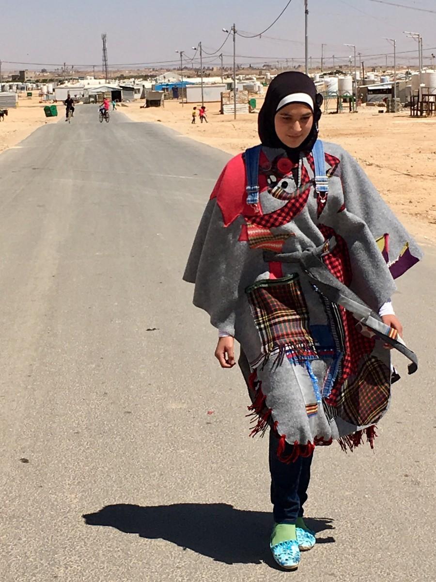 A-TIGER-Girl-in-Zaatari-wearing-the-LoveCoats-prototype-LoveCoats