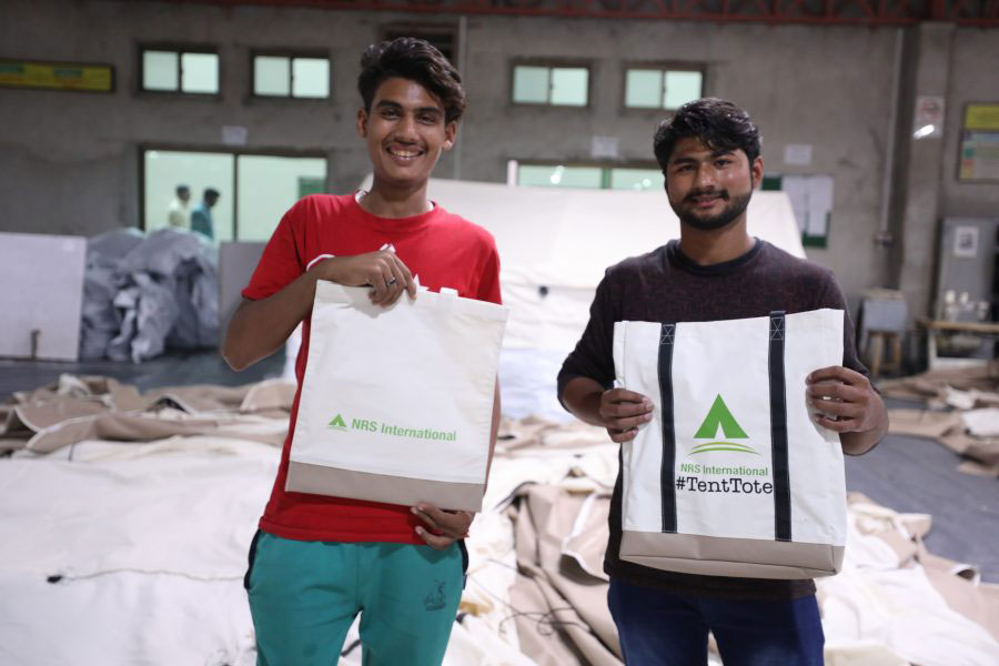 boys standing with Tenttotes a bag of full hope Tenttotes CSR upcycling project