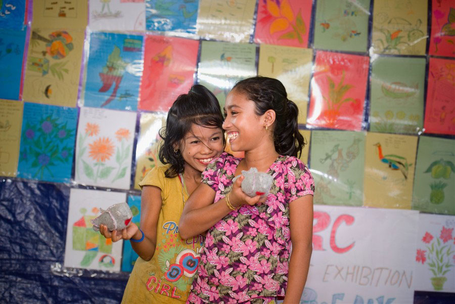 refugee girls smiling with Peacedoves in Bangladesh 2018