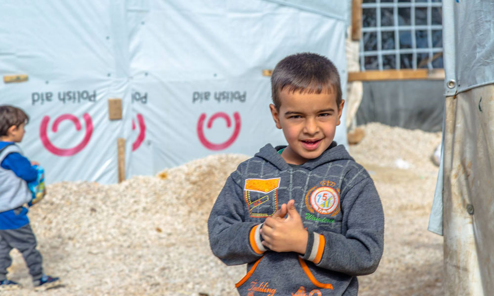 refugee smiles at NRS Relief Arsal camp Lebanon 2018