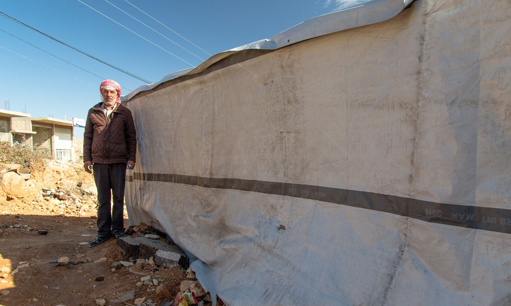 refugee standing near from NRS Relief Arsal camp at Lebanon in 2018
