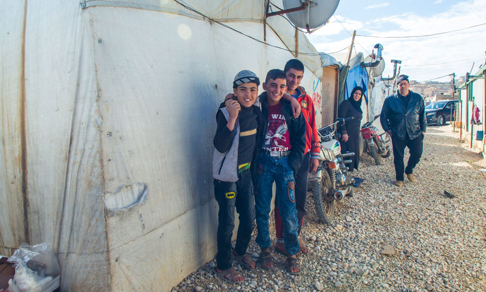 smiling faces of refugees at NRS Relief Arsal camp Lebanon 2018