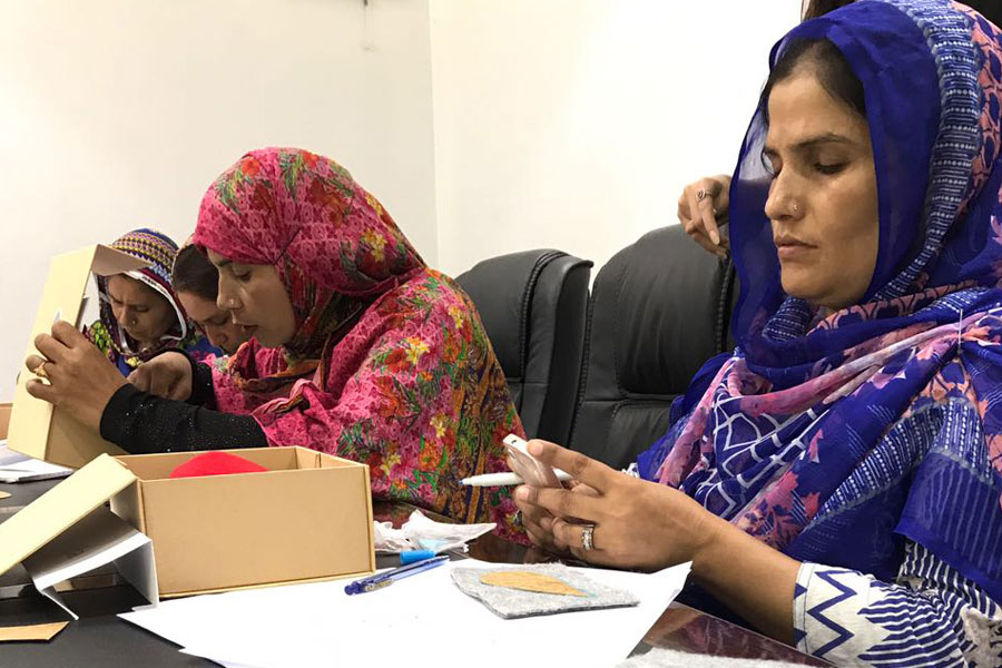 women working on peace doves NRS Relief project in 2018