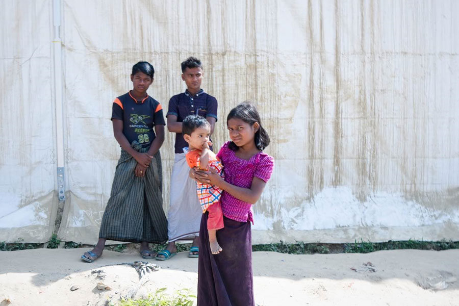 girl refugee at MSU UNHCR standard tent by NRS Relief in Kutupalong Bangladesh