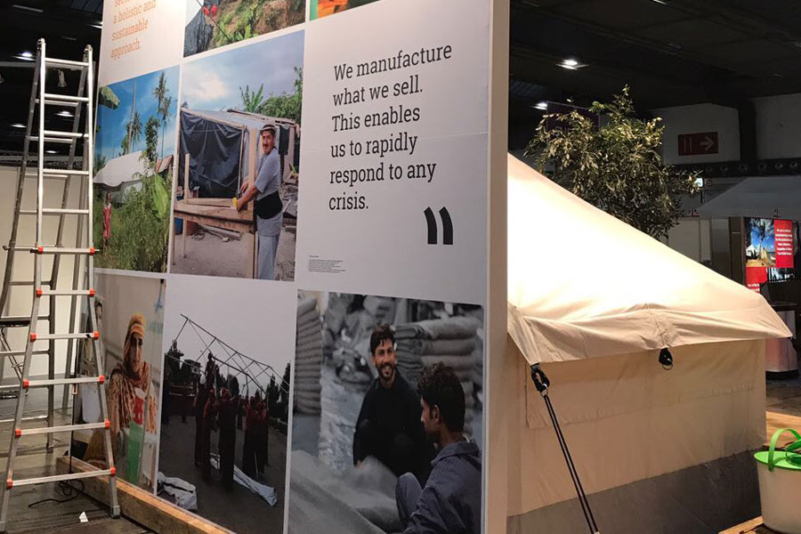 humanitarian billboard of NRS International at AidEx 2017 Brussels Expo