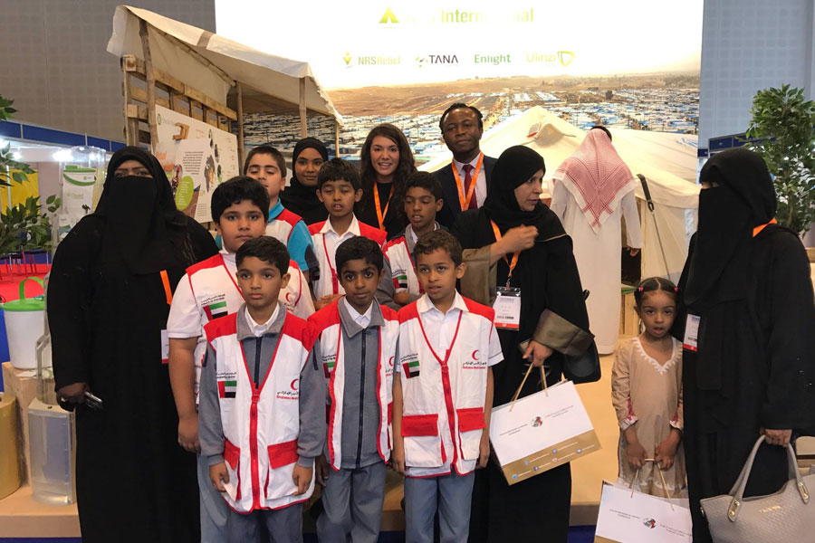 kids visiting NRS Relief booth at DIHAD 2017 event