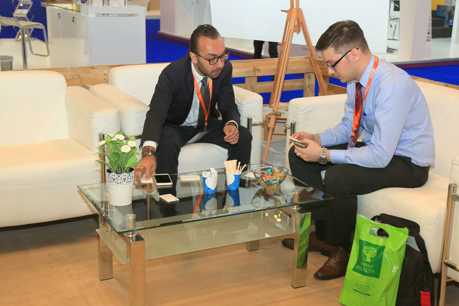NRS Relief team representative sitting with guest at DIHAD 2017