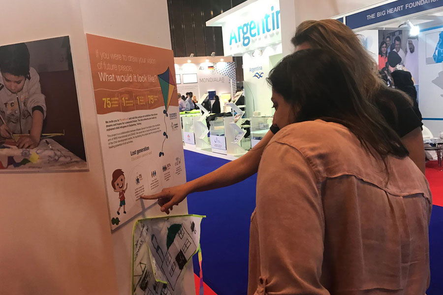 NRS Relief team representative speaking with guest at DIHAD 2017