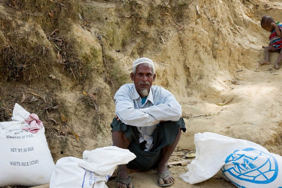 refugee sitting on mud Kutupalong camp Coxs Bazaar Bangladesh