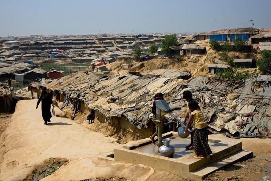 refugee taking water at Kutupalong camp Coxs Bazaar Bangladesh