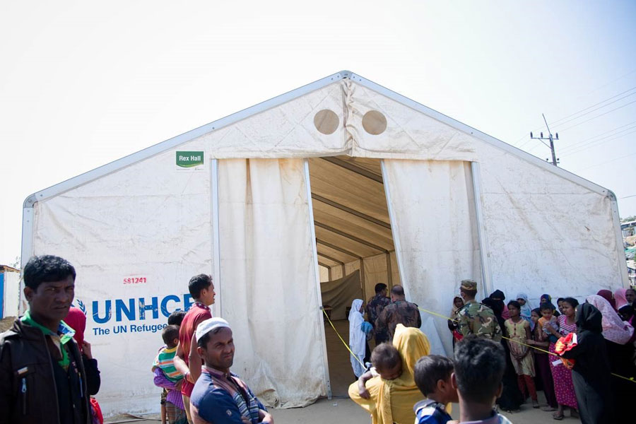 refugees standing in front of MSU tent by NRS Relief at Kutupalong Bangladesh
