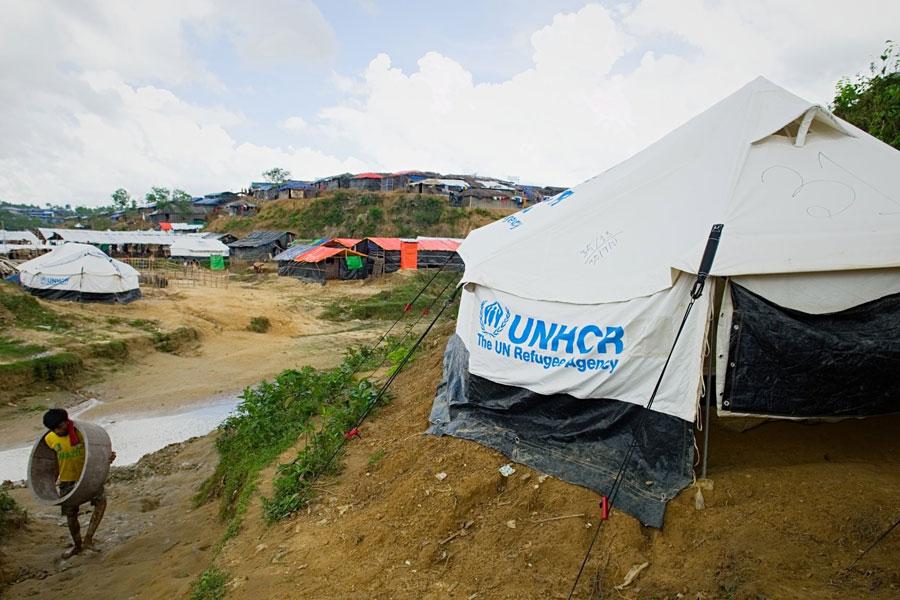 Rohingya refugee boy front left tent door at Kutupalong camp Bangladesh