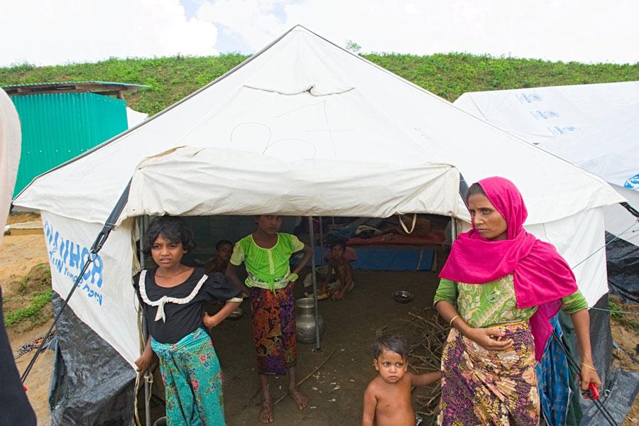 Rohingya refugees front door tent in Kutupalong Bangladesh