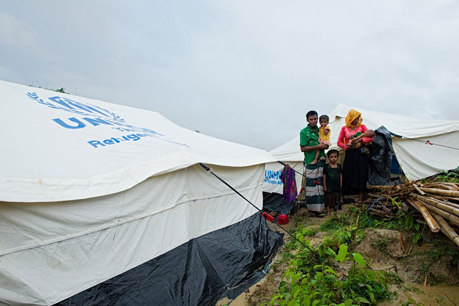 Rohingya refugees standing in front of camp at Kutupalong Bangladesh