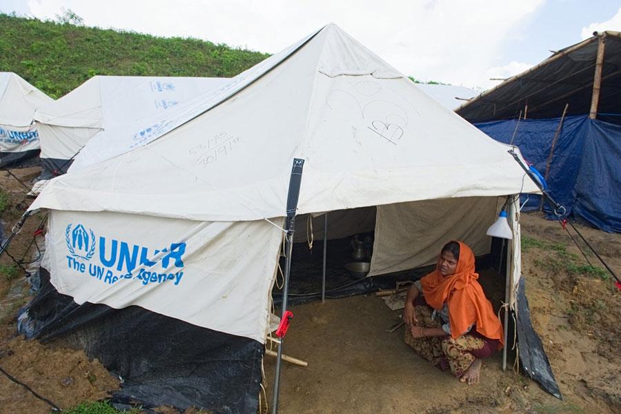 Rohingya refugees women sitting in front door at Kutupalong camp Bangladesh