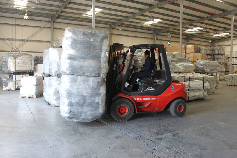 changing packages with car lifter at NRS Relief logistics in Dubai warehouse 2016