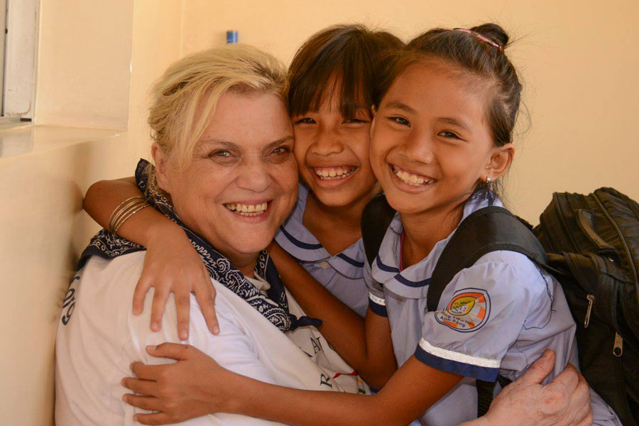 founder of Christina Noble Children Foundation with kids in 2016