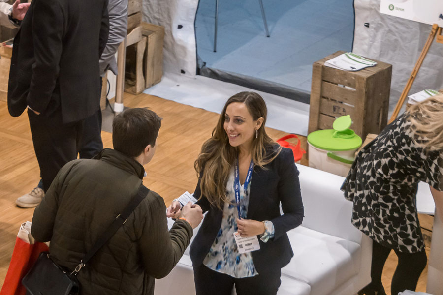 Francisca explaining people at AidEx event 2016 Brussels Expo