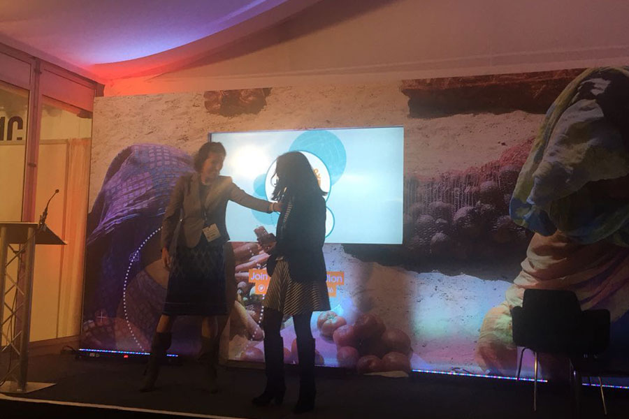Girl receiving award at AidEx event 2016 Brussels Expo