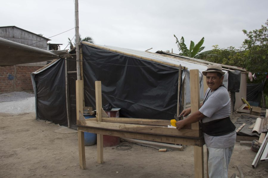 men working in front of their shelter at Ecuador in 2016