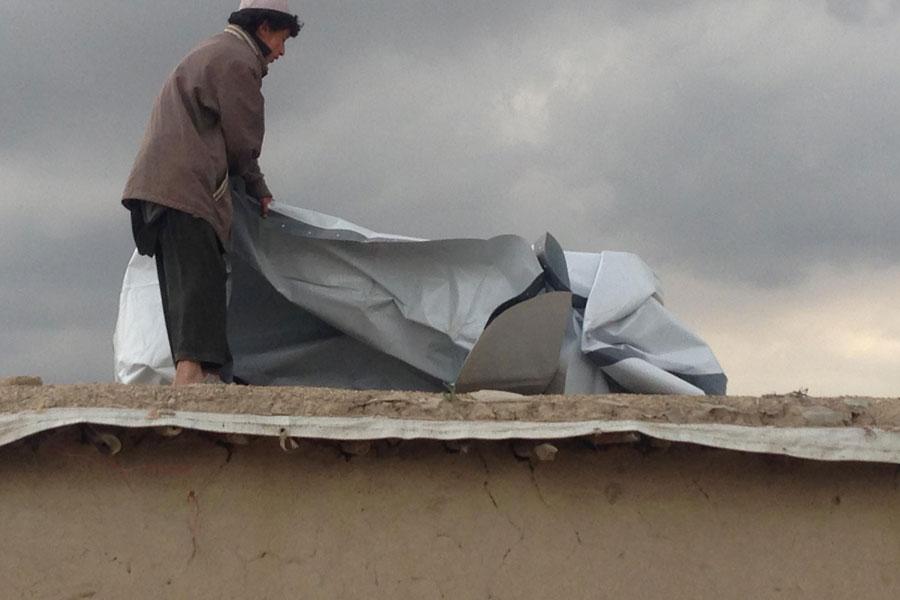 NRS Relief distributing tarpaulins in Afghanistan 2016