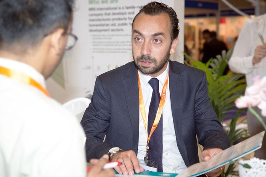 NRS Relief representative explaining their company at DIHAD 2016