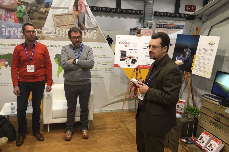 NRS team explaining about solar lights at AidEx event 2016 Brussels Expo