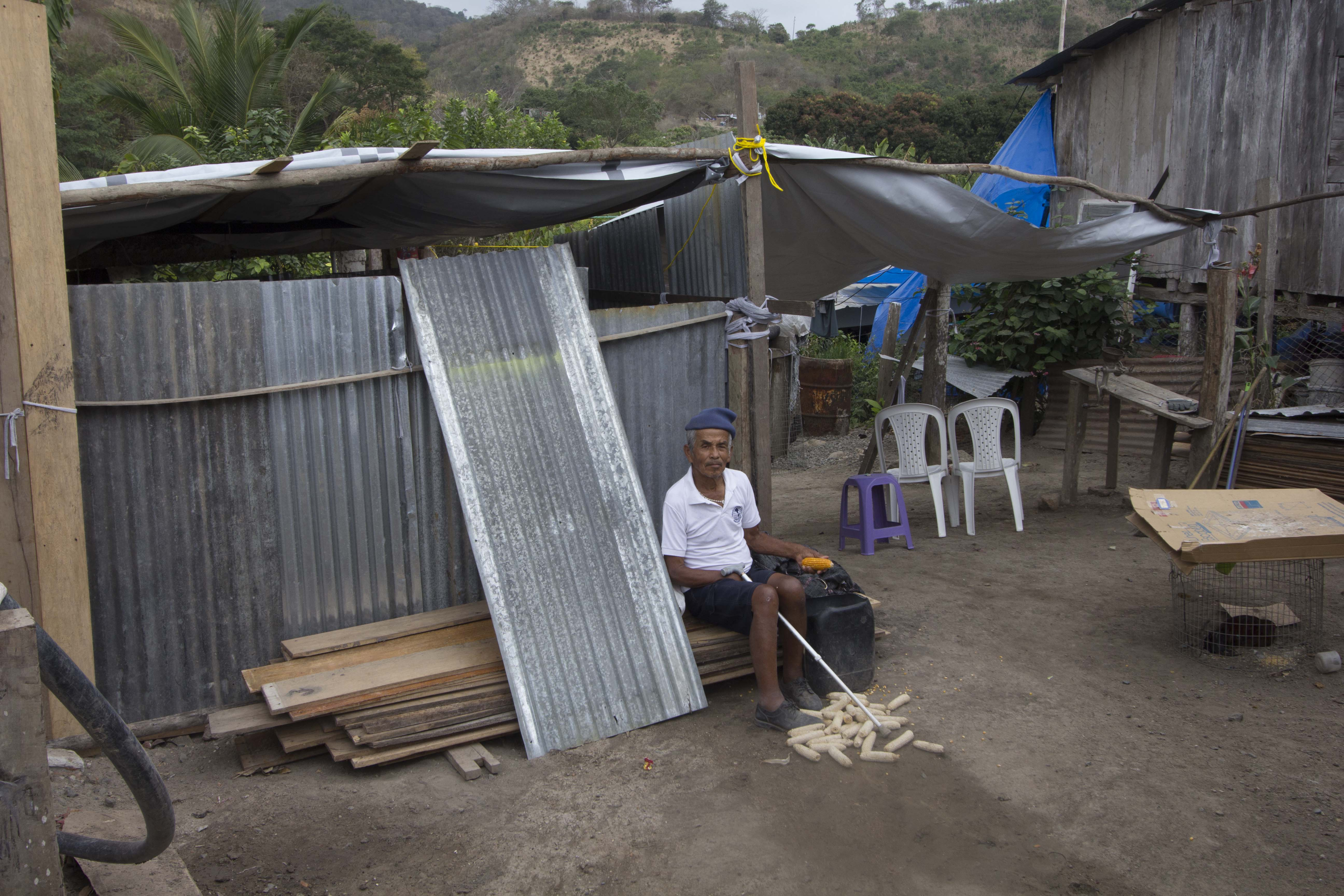 old men is sitting under the NRS Relief tarpaulins at Ecuador in 2016