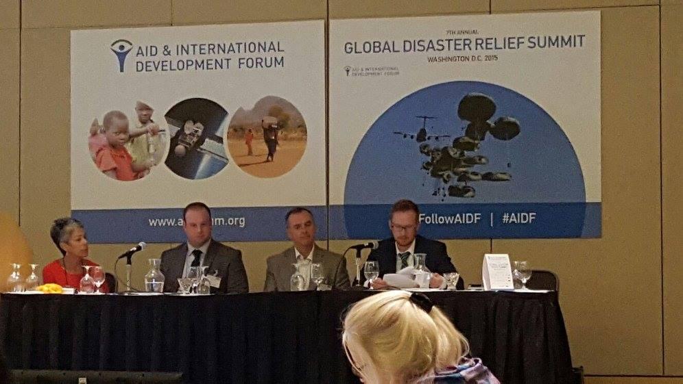 panel of Aid International Development Forum in 2015
