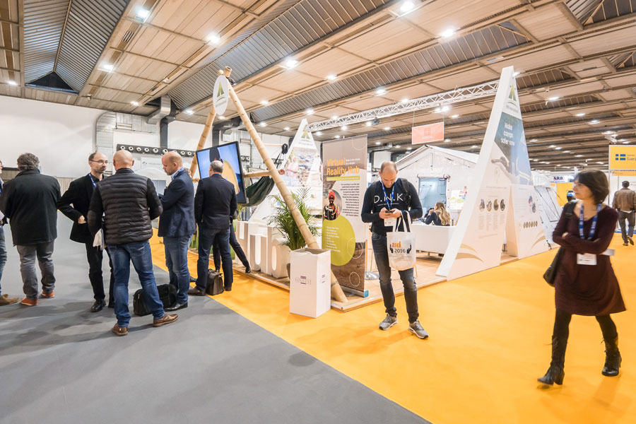 people standing in front of NRS Relief booth at AidEx event 2016 Brussels Expo