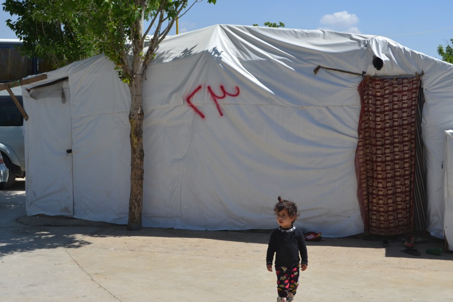 refugee standing in front of NRS Relief tent at Lebanon 2017