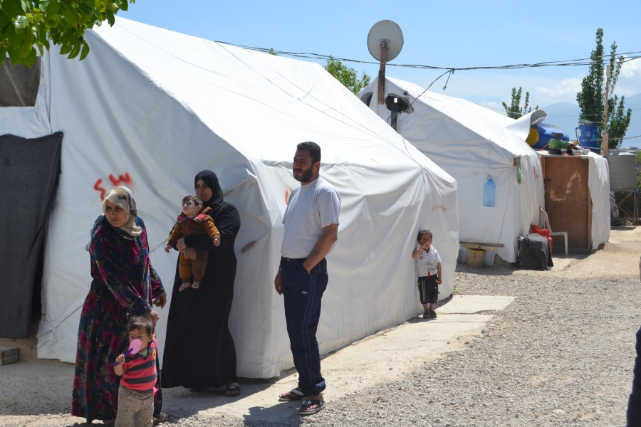refugee standing in front of tent at Lebanon in 2017