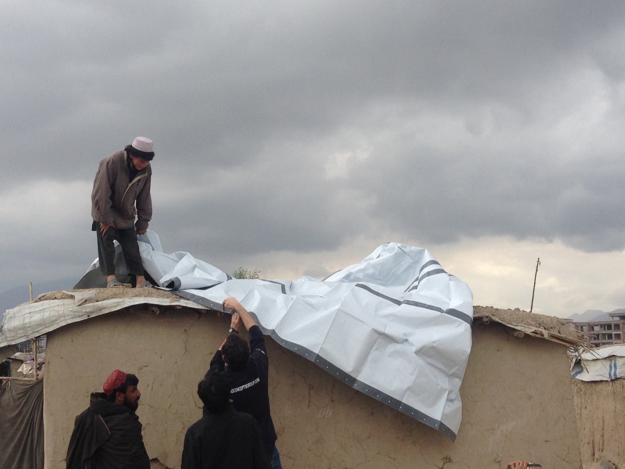 refugee using tarpaulins for home in Afghanistan 2016