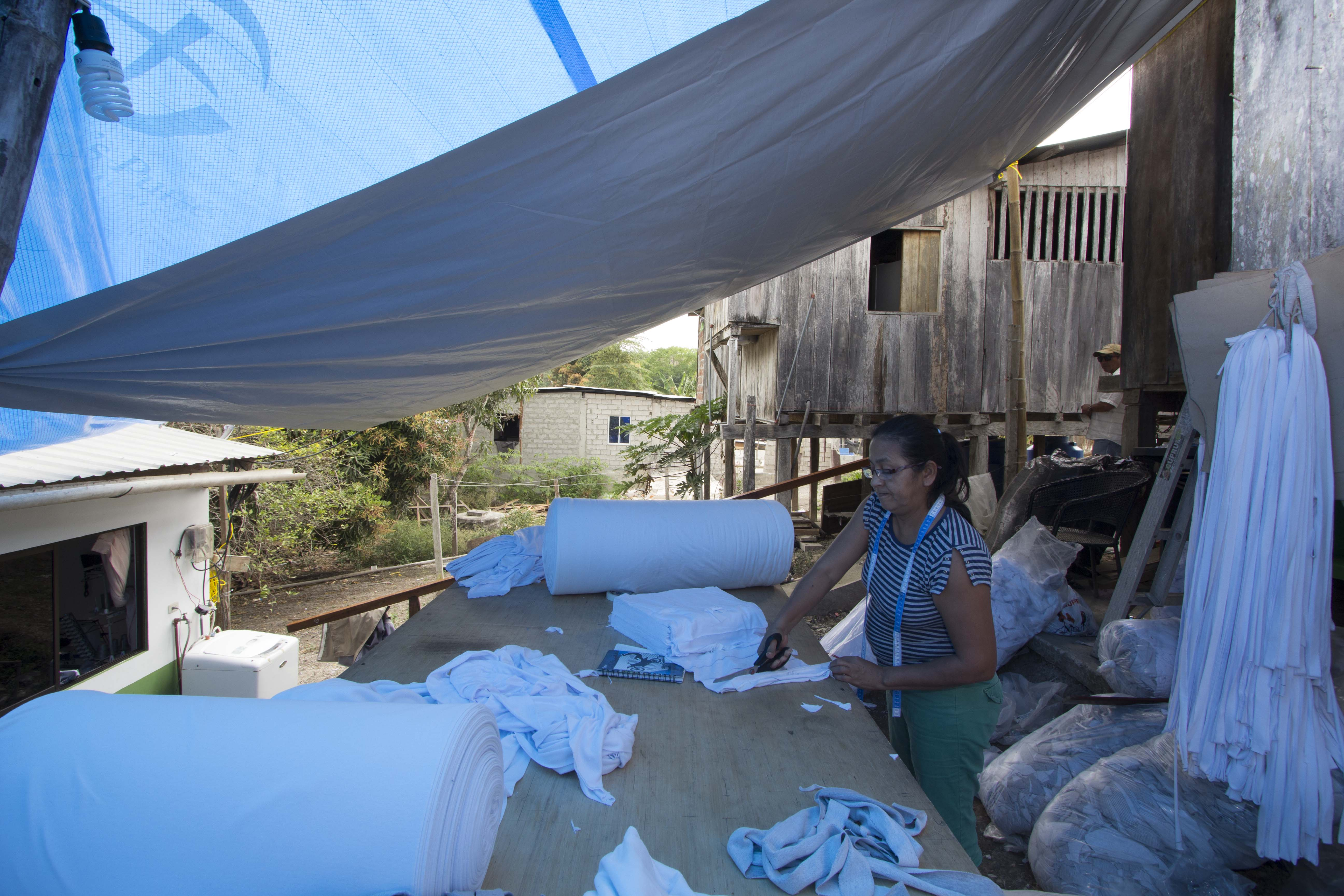 refugee working under the NRS tarpaulins at Ecuador in 2016