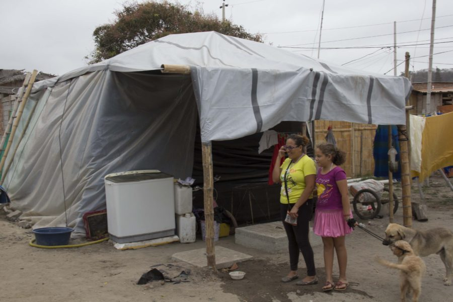 refugees standing in front of their home at Ecuador in 2016