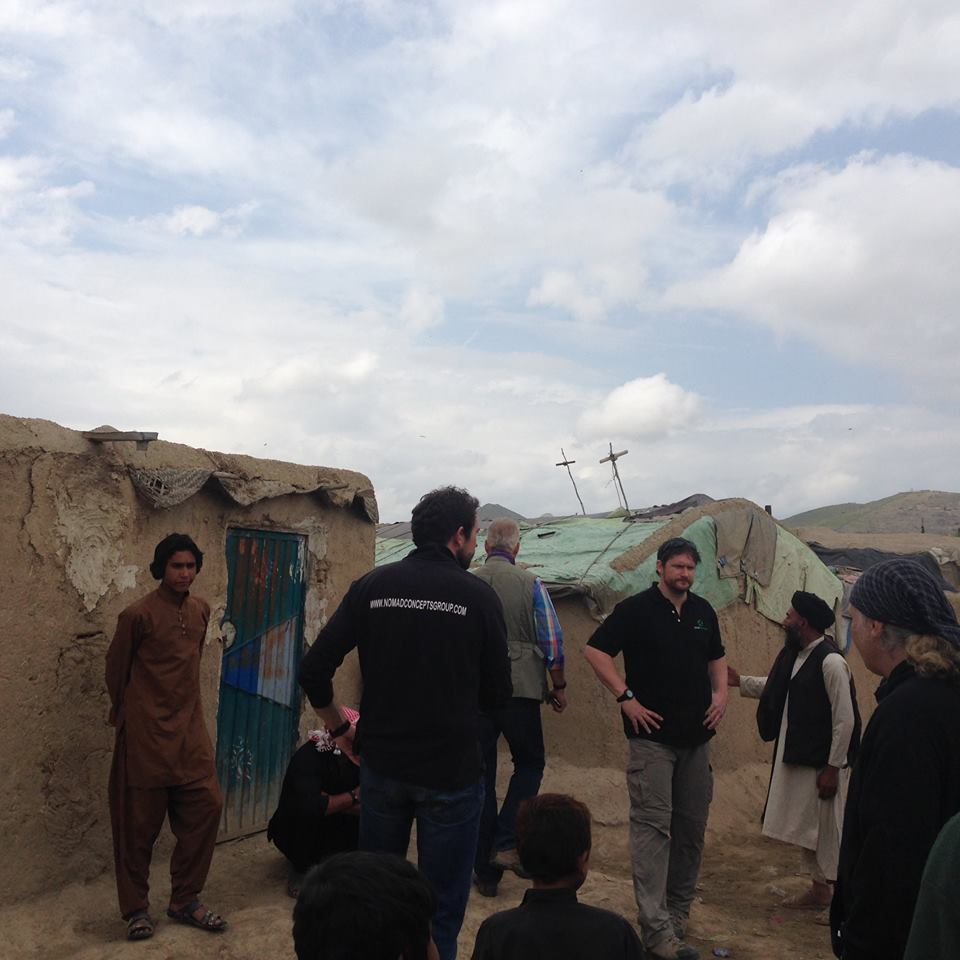 refugees standing with NRS team in Afghanistan 2016