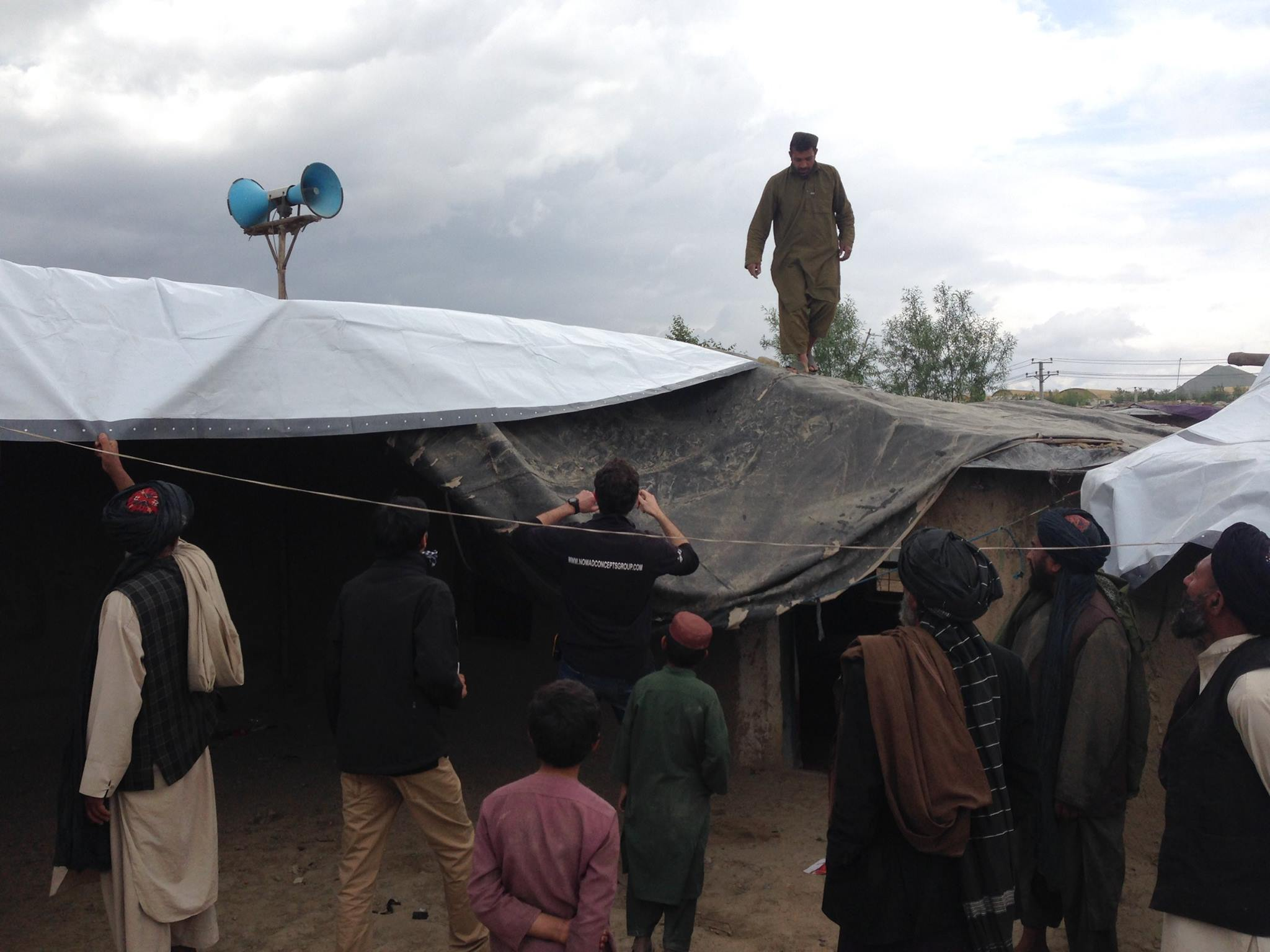 refugees with NRS tarpaulins in Afghanistan 2016