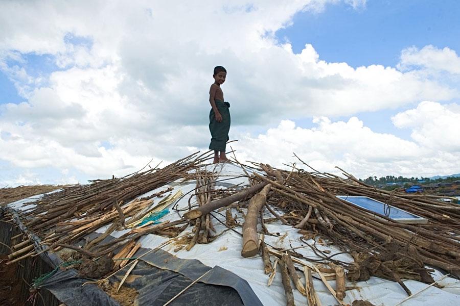 Rohingya refugees standing on tent at Kutupalong camp Bangladesh
