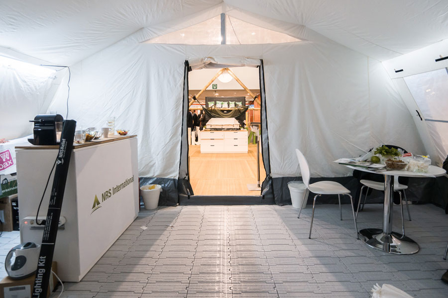 tent inner view of NRS Relief booth at AidEx event 2016 Brussels Expo