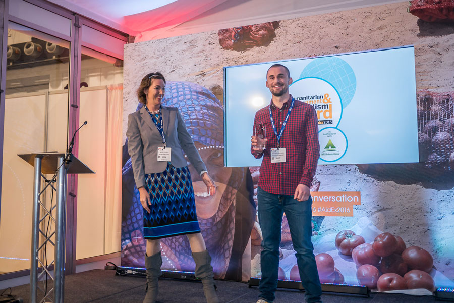 Wieke giving the best Journalism award to boy at AidEx event 2016 Brussels Expo