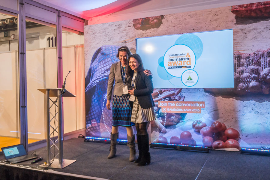 Wieke giving the best Journalism award to girl at AidEx event 2016 Brussels Expo