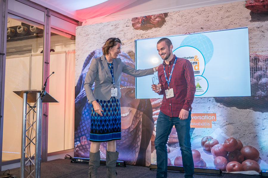Wieke NRS International representative giving awards at AidEx event 2016 Brussels Expo