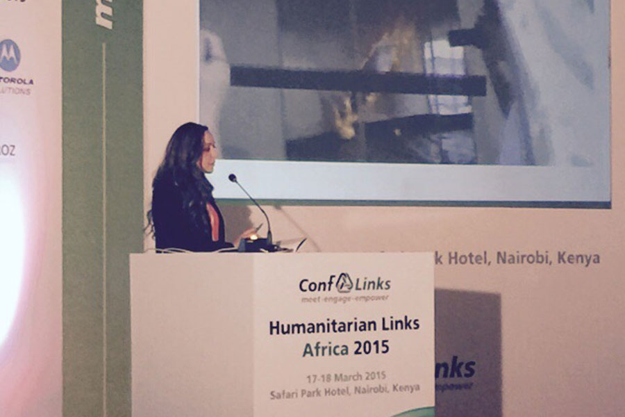 NRS Representative explaining their company at annual Humanitarian conf links Africa Summit 2015
