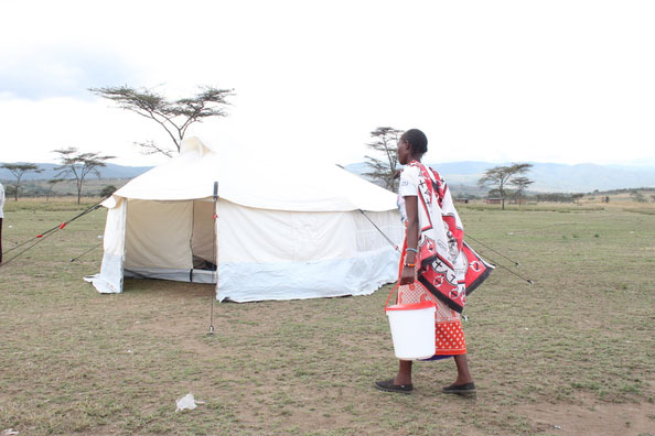 refugee taking in Jerry buckets of NRS Relief in Kenya 2015